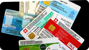 Swiss health insurance cards from various providers. Source: http://www.radiofm1.ch/mediathek/at/12682 [11.02.2014].