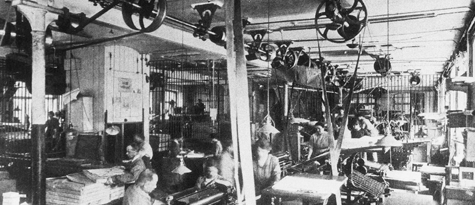 Factory hall, presumably a printing hall, around 1900-1920, source: Sozialarchiv, Zurich.